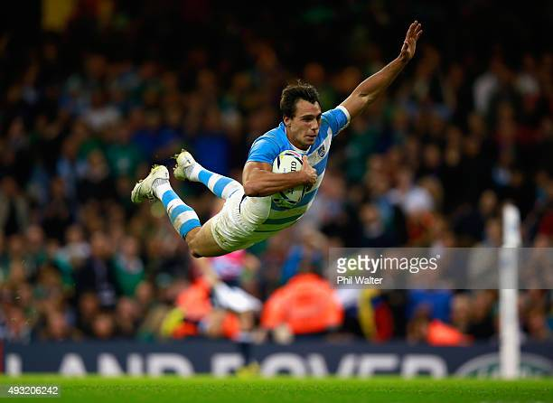 Juan Imhoff of Argentina dives over the line to score his team's fourth try during the 2015 Rugby World Cup Quarter Final match between Ireland and...