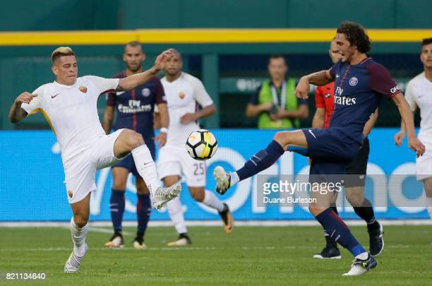 Juan Iturbe of AS Roma battles Adrien Rabiot of Paris SaintGermain for the ball during the first half at Comerica Park on July 19 2017 in Detroit...