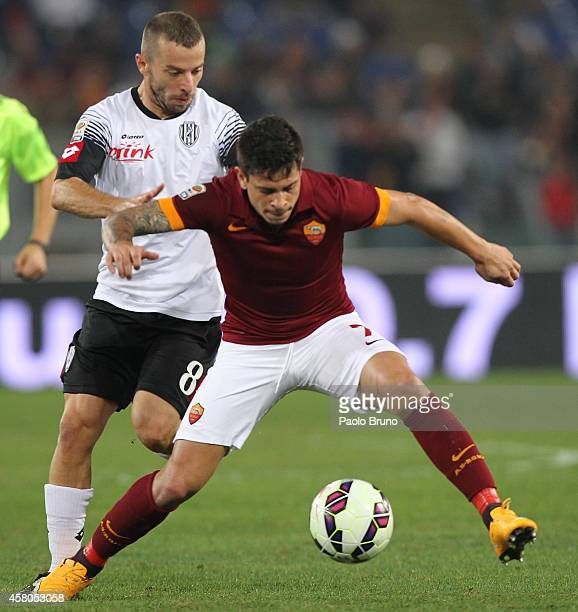 Juan Iturbe of AS Roma competes for the ball with Giuseppe De Feudis of AC Cesena during the Serie A match between AS Roma and AC Cesena at Stadio...