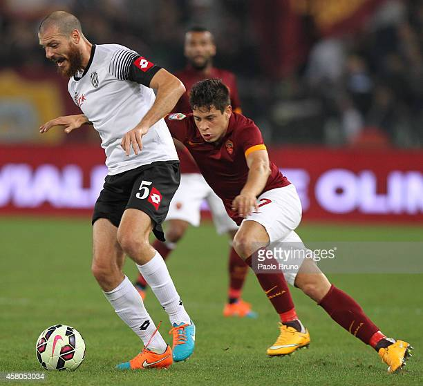 Juan Iturbe of AS Roma competes for the ball with Luigi Giorgi of AC Cesena during the Serie A match between AS Roma and AC Cesena at Stadio Olimpico...