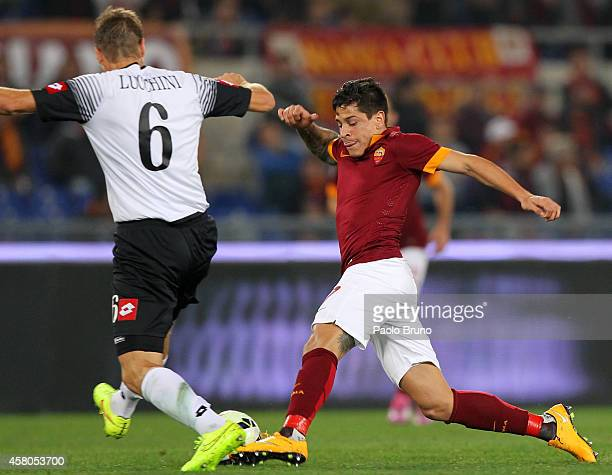 Juan Iturbe of AS Roma competes for the ball with Stefano Lucchini of AC Cesena during the Serie A match between AS Roma and AC Cesena at Stadio...