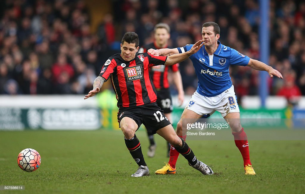 Juan Iturbe of Bournemouth and <a gi-track='captionPersonalityLinkClicked' href=/galleries/search?phrase=Michael+Doyle+-+Soccer+Player&family=editorial&specificpeople=13446353 ng-click='$event.stopPropagation()'>Michael Doyle</a> of Portsmouth compete for the ball during the Emirates FA Cup Fourth Round match between Portsmouth and AFC Bournemouth at Fratton Park on January 30, 2016 in Portsmouth, England.