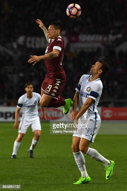 Juan Iturbe of FC Torino goes up against Ivan Perisic of FC Internazionale during the Serie A match between FC Torino and FC Internazionale at Stadio...
