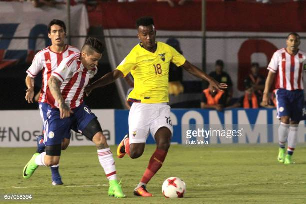 Juan Iturbe of Paraguay and Jeffrerson Orejuela of Ecuador fight for the ball during a match between Paraguay and Ecuador as part of FIFA 2018 World...