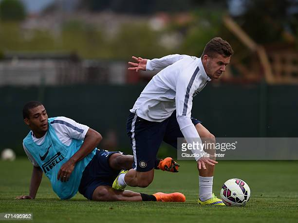 Juan Jesus and George Puscas compete for the ball during FC Internazionale training session at the club's training ground at Appiano Gentile on April...