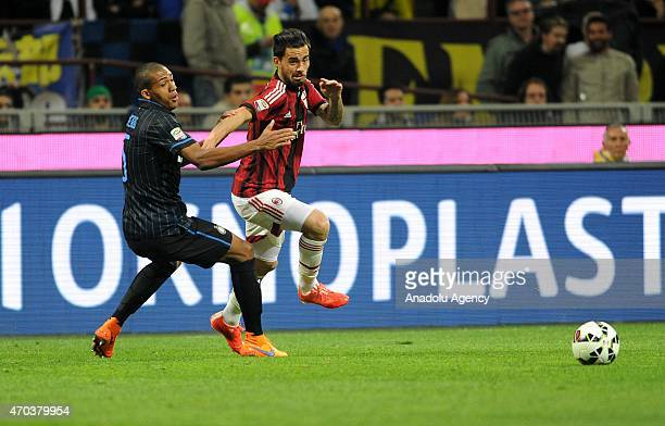 Juan Jesus of FC Internazionale in action with Suso of AC Milan during the Serie A match between FC Internazionale Milano and AC Milan at Stadio...
