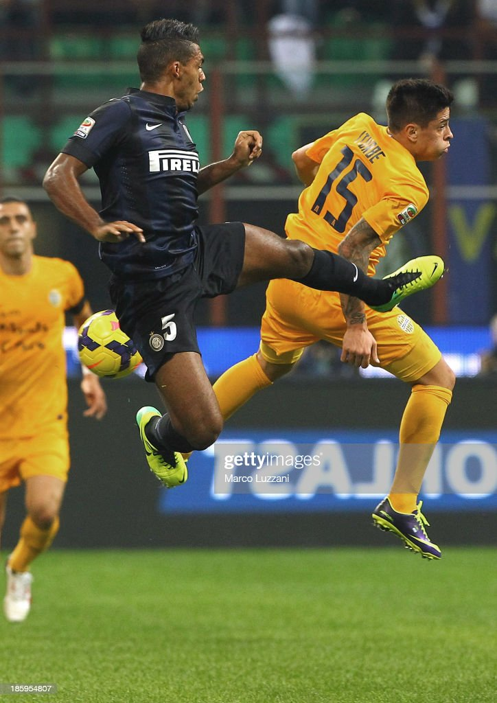 Juan Jesus of FC Internazionale Milano (L) and <a gi-track='captionPersonalityLinkClicked' href=/galleries/search?phrase=Juan+Manuel+Iturbe&family=editorial&specificpeople=7492436 ng-click='$event.stopPropagation()'>Juan Manuel Iturbe</a> of Hellas Verona FC compete for the ball during the Serie A match between FC Internazionale Milano and Hellas Verona at Stadio Giuseppe Meazza on October 26, 2013 in Milan, Italy.