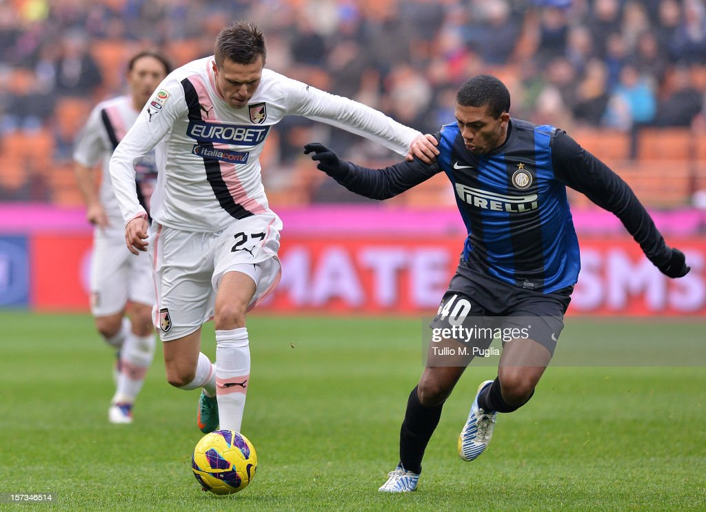 Juan Jesus (R) of Inter and <a gi-track='captionPersonalityLinkClicked' href=/galleries/search?phrase=Josip+Ilicic&family=editorial&specificpeople=7151628 ng-click='$event.stopPropagation()'>Josip Ilicic</a> of Palermo compete for the ball during the Serie A match between FC Internazionale Milano and US Citta di Palermo at San Siro Stadium on December 2, 2012 in Milan, Italy.