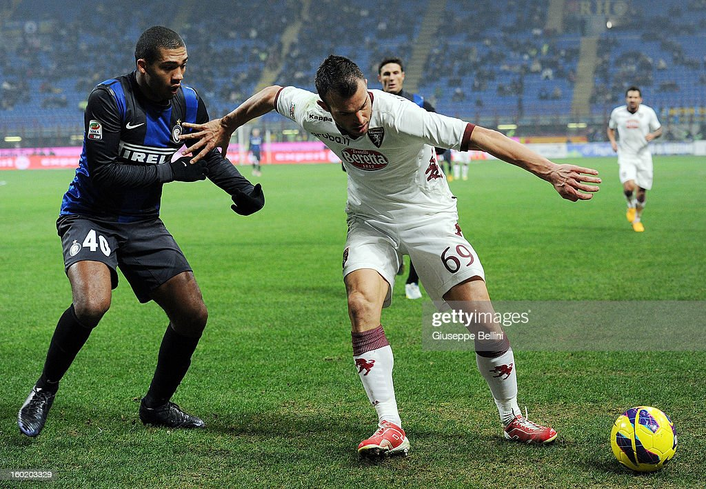 Juan Jesus of Inter and Riccardo Meggiorini of Torino in action during the Serie A match between FC Internazionale Milano and Torino FC at San Siro Stadium on January 27, 2013 in Milan, Italy.