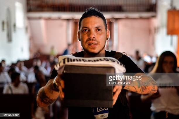 Juan Jose Herrera the son of Ismael Enrique Arciniegas who was arrested and executed in China for drug trafficking holds the urn with his ashes...