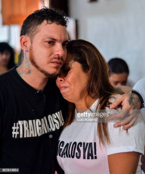 Juan Jose Herrera the son of Ismael Enrique Arciniegas who was arrested and executed in China for drug trafficking hugs a relative during during his...