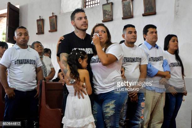 Juan Jose Herrera the son of Ismael Enrique Arciniegas who was arrested and executed in China for drug trafficking hugs relatives during during his...