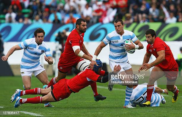 Juan Jose Imhoff of Argentina is tackled by Alexander Todua of Georgia during the IRB 2011 Rugby World Cup Pool B match between Argentina and Georgia...