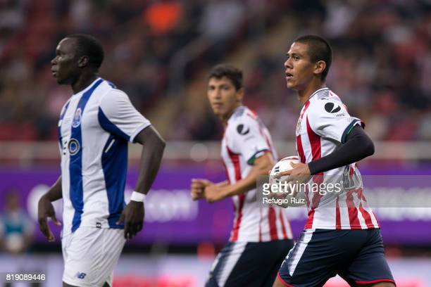 Juan Jose Macias of Chivas holds the ball after scoring the first goal of his team during the friendly match between Chivas and Porto at Chivas...