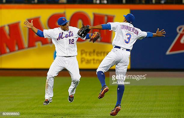 Juan Lagares and Curtis Granderson of the New York Mets celebrate after defeating the Philadelphia Phillies at Citi Field on September 23 2016 in the...