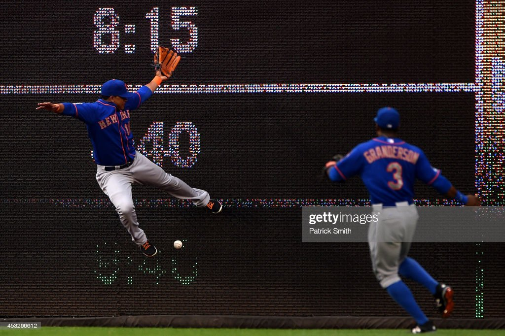 Juan Lagares of the New York Mets cannot make a catch in the first inning against the Washington Nationals at Nationals Park on August 6 2014 in...