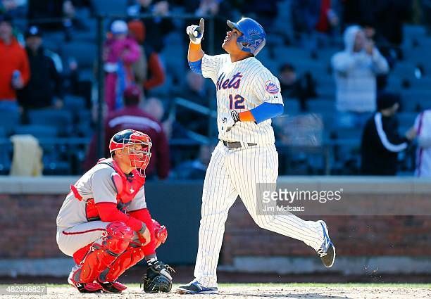 Juan Lagares of the New York Mets celebrates his home run as Jose Lobaton of the Washington Nationals looks on during their Opening Day game at Citi...