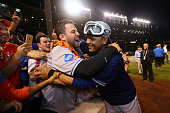 Juan Lagares of the New York Mets celebrates with fans after defeating the Chicago Cubs in game four of the 2015 MLB National League Championship...