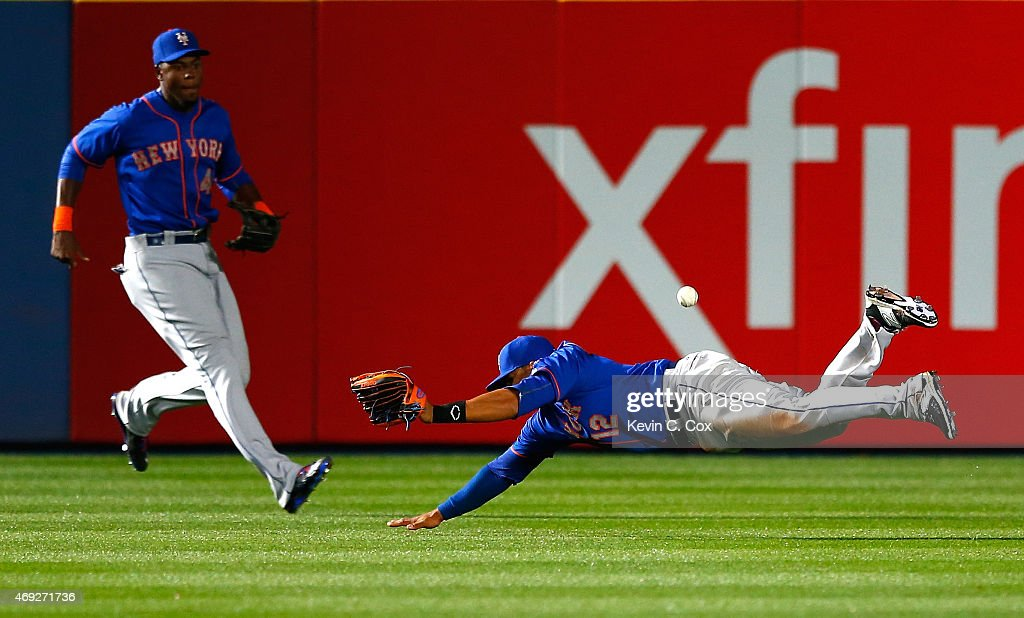 Juan Lagares of the New York Mets fails to catch this ball in the eighth inning that resulted in a double by Chris Johnson of the Atlanta Braves...