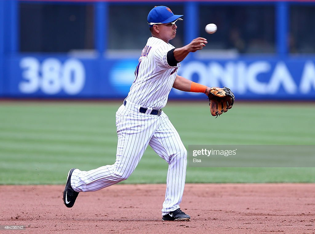 Juan Lagares #12 of the New York Mets fields a hit by Jeff Locke of the Pittsburgh Pirates in the third inning on August 16, 2015 at Citi Field in the Flushing neighborhood of the Queens borough of New York City.
