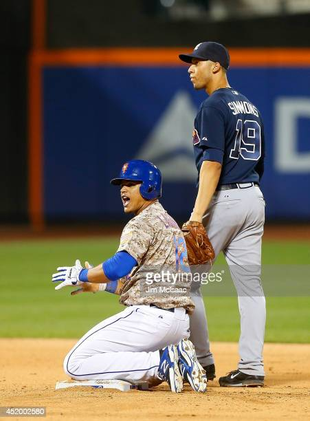 Juan Lagares of the New York Mets in action against Andrelton Simmons of the Atlanta Braves at Citi Field on July 7 2014 in the Flushing neighborhood...