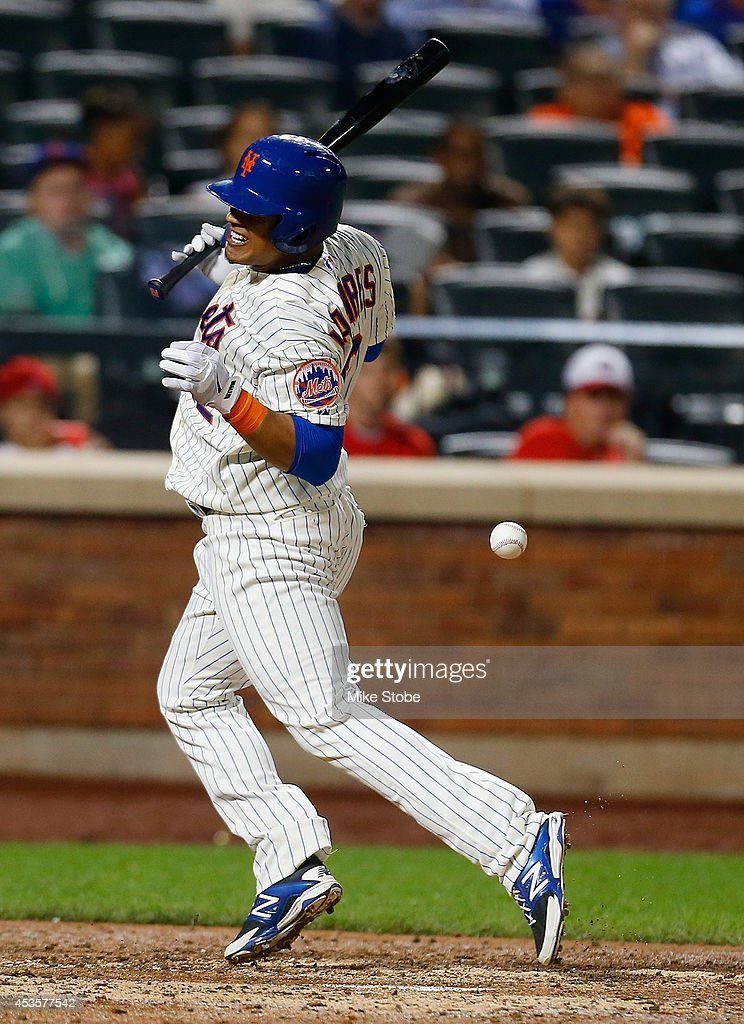 <a gi-track='captionPersonalityLinkClicked' href=/galleries/search?phrase=Juan+Lagares&family=editorial&specificpeople=8960493 ng-click='$event.stopPropagation()'>Juan Lagares</a> #12 of the New York Mets is hit by a pitch in the seventh inning against the Washington Nationals at Citi Field on August 13, 2014 in the Flushing neighborhood of the Queens borough of New York City.