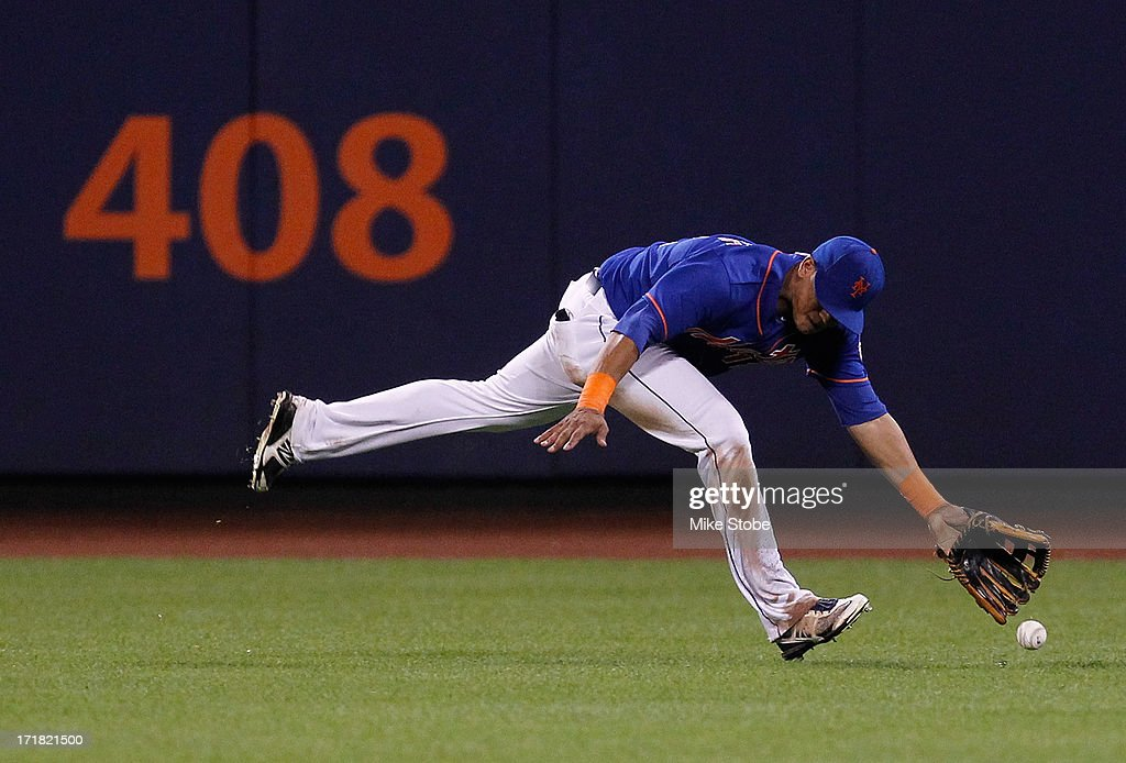 Juan Lagares #12 of the New York Mets is unable to catch a double off the bat of <a gi-track='captionPersonalityLinkClicked' href=/galleries/search?phrase=Ian+Desmond&family=editorial&specificpeople=835572 ng-click='$event.stopPropagation()'>Ian Desmond</a> #20 of the Washington Nationals in the ninth inning at Citi Field on June 28, 2013 at Citi Field in the Flushing neighborhood of the Queens borough of New York City. Nationals defeated the Mets 6-4.