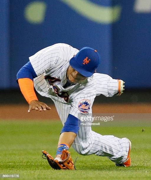 Juan Lagares of the New York Mets makes a diving catch on a ball hit by Pedro Severino for an out during the 8th inning of an MLB baseball game...
