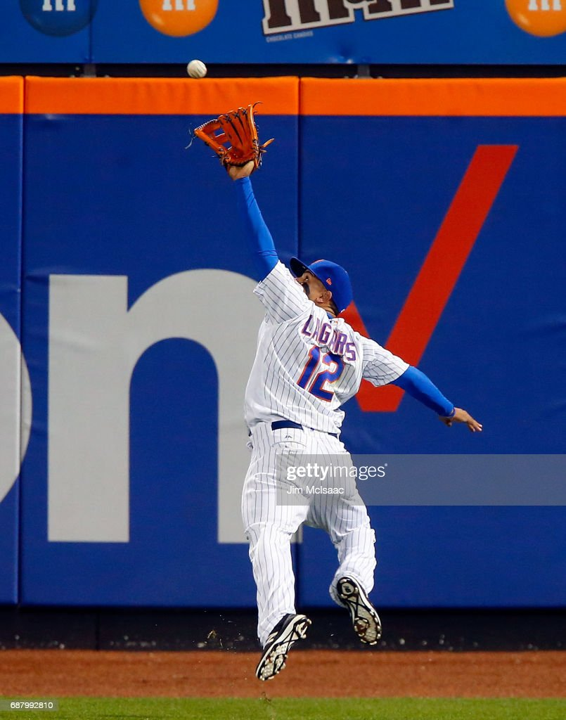 Juan Lagares #12 of the New York Mets makes a running catch for the first out of the eighth inning against the San Diego Padres at Citi Field on May 24, 2017 in the Flushing neighborhood of the Queens borough of New York City.