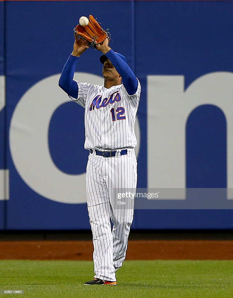<a gi-track='captionPersonalityLinkClicked' href=/galleries/search?phrase=Juan+Lagares&family=editorial&specificpeople=8960493 ng-click='$event.stopPropagation()'>Juan Lagares</a> #12 of the New York Mets makes the catch for the out in the seventh inning against the San Francisco Giants at Citi Field on April 29, 2016 in the Flushing neighborhood of the Queens borough of New York City.