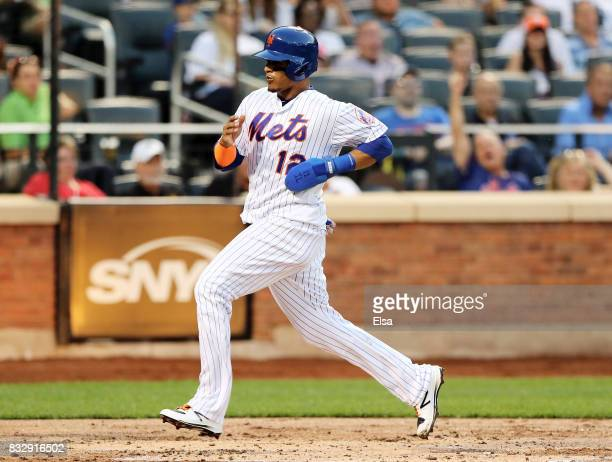Juan Lagares of the New York Mets scores off a sacrifice fliy from teammate Yoenis Cespedes in the first inning against the New York Yankees during...