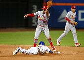 Juan Lagares of the New York Mets steals second base before Greg Garcia of the St Louis Cardinals can get the tag down in the seventh inning during...