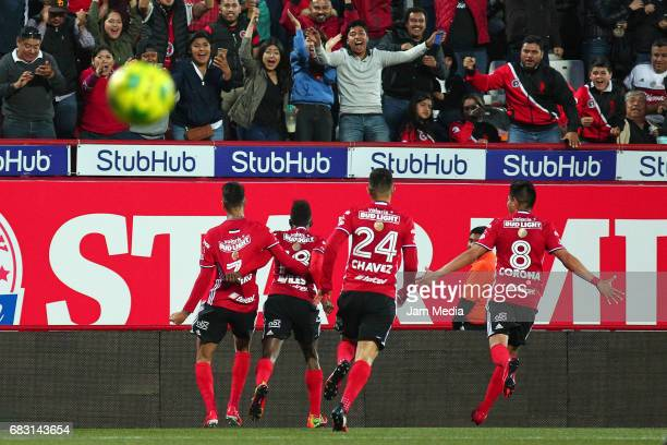 Juan Lucero Aviles Hurtado Luis Chavez and Joe Corona of Tijuana celebrate their team's second goal during the quarter finals second leg match...