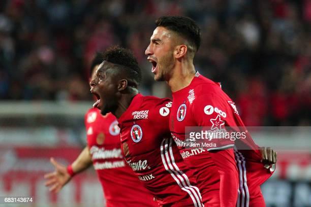 Juan Lucero of Tijuana celebrates with teammate Aviles Hurtado after scoring his team's second goal during the quarter finals second leg match...