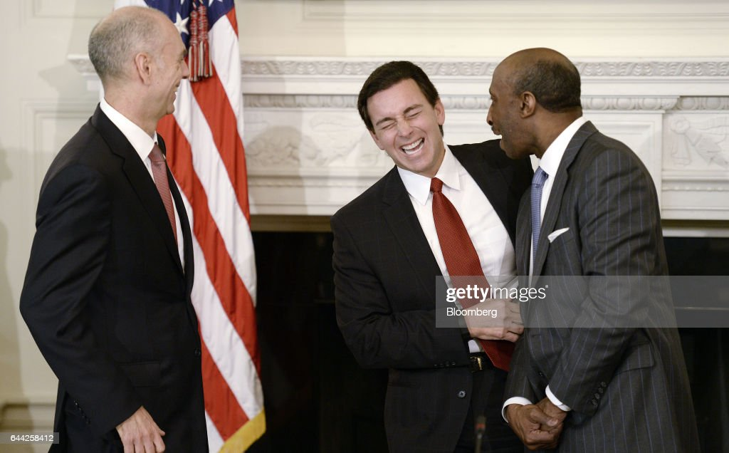 Juan Luciano, chairman and chief executive officer of Archer Daniels Midland Co., from left, Mark Fields, president and chief executive officer of Ford Motor Co., and Kenneth Frazier, chairman and chief executive officer of Merck & Co., share a laugh during a meeting with U.S. President Donald Trump, not pictured, and manufacturing executives in the State Dining Room of the White House in Washington, D.C., U.S., on Thursday, Feb. 23, 2017. Trump told some of America's most prominent corporate executives that he intends to put them to work restoring manufacturing jobs and U.S. dominance in trade. Photographer: Olivier Douliery/Bloomberg via Getty Images