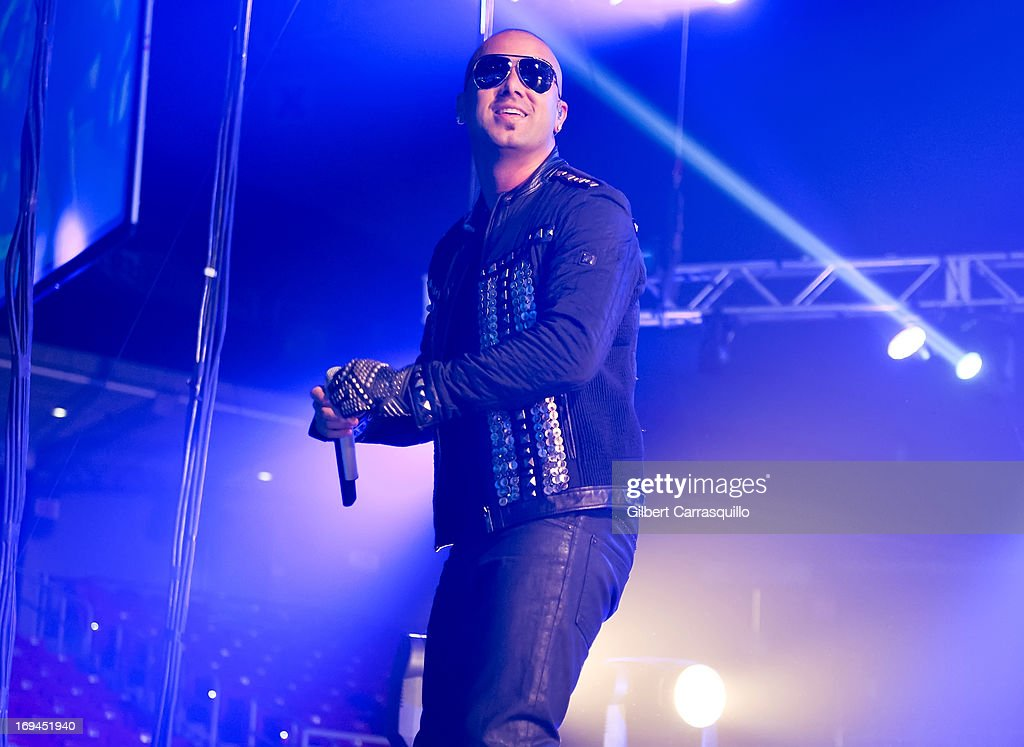 Juan Luis Morera Luna aka '<a gi-track='captionPersonalityLinkClicked' href=/galleries/search?phrase=Wisin&family=editorial&specificpeople=666169 ng-click='$event.stopPropagation()'>Wisin</a>' of <a gi-track='captionPersonalityLinkClicked' href=/galleries/search?phrase=Wisin&family=editorial&specificpeople=666169 ng-click='$event.stopPropagation()'>Wisin</a> y Yandel performs during Lideres World Tour 2013 at the Liacouras Center on May 24, 2013 in Philadelphia, Pennsylvania.