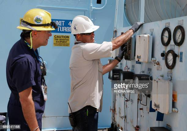Juan Madruga and Pehter Rodriguez of Florida Power and Light work on the Turkey Point Nuclear Reactor in Homestead Florida May 18 2017 The plant...