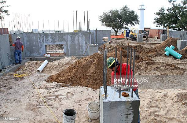 Juan Manuel Cruz does concrete work on a piling at the Biloxi Visitor's Center under construction on US 90 north of the Biloxi Lighthouse in January...