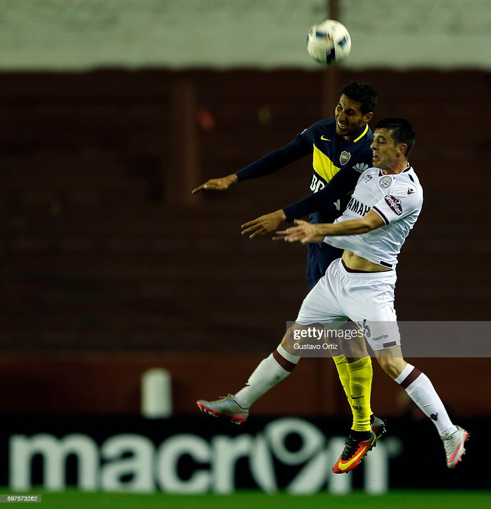 Juan Manuel Insaurralde of Boca Juniors and Brian Montenegro of Lanus head the ball during a match between Lanus and Boca Juniors as part of first...