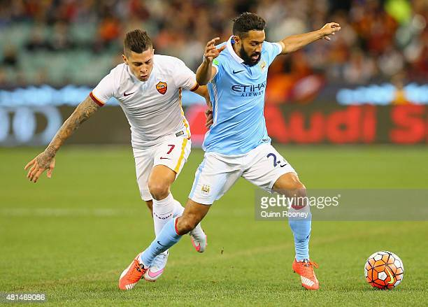 Juan Manuel Iturbe of AS Roma and Gael Clichy of Manchester City compete for the ball during the International Champions Cup friendly match between...