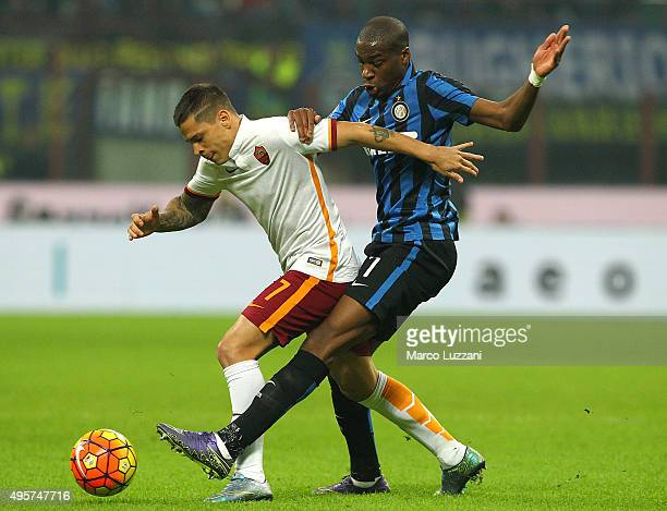 Juan Manuel Iturbe of AS Roma competes for the ball with Geoffrey Kondogbia of FC Internazionale Milano during the Serie A match between FC...