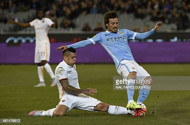 Juan Manuel Iturbe of AS Roma fights for the ball with David Silva of Manchester City during the International Champions Cup football match between...