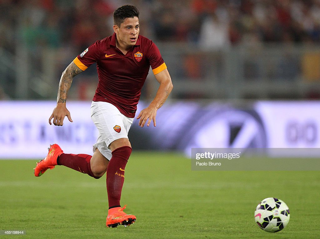 <a gi-track='captionPersonalityLinkClicked' href=/galleries/search?phrase=Juan+Manuel+Iturbe&family=editorial&specificpeople=7492436 ng-click='$event.stopPropagation()'>Juan Manuel Iturbe</a> of AS Roma in action during the Serie A match between AS Roma and ACF Fiorentina at Stadio Olimpico on August 30, 2014 in Rome, Italy.