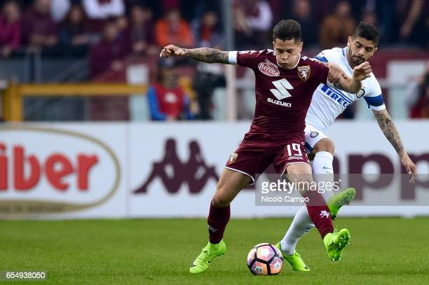 Juan Manuel Iturbe of Torino FC and Ever Banega of FC Internazionale compete for the ball during the Serie A football match between Torino FC and FC...