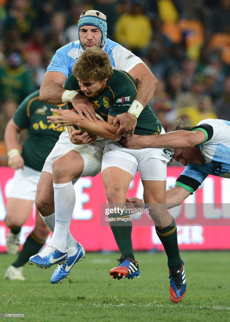 Juan Manuel Leguizamon of Argentina tackles Pat Lambie of the Springboks during the Castle Rugby Championship match between South Africa and Argentina at FNB Stadium on August 17, 2013 in Soweto, South Africa.