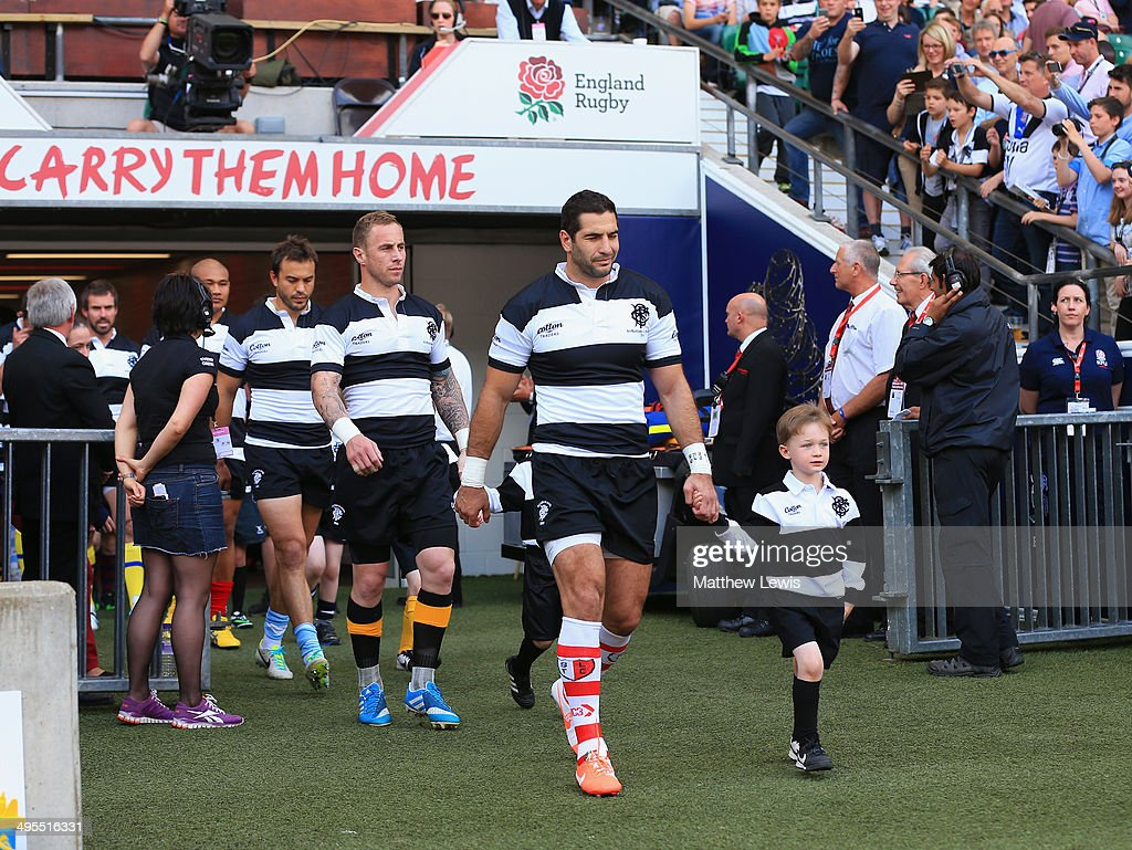 Juan Manuel Leguizamon of the Barbarians walks out with a player escort during the Rugby Union International Match between England and The Barbarians at Twickenham Stadium on June 1, 2014 in London, England