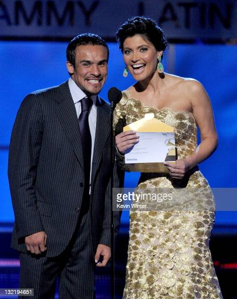 Juan Manuel Marquez and Chiquinquira Delgado speak onstage during the 12th annual Latin GRAMMY Awards at the Mandalay Bay Events Center on November...