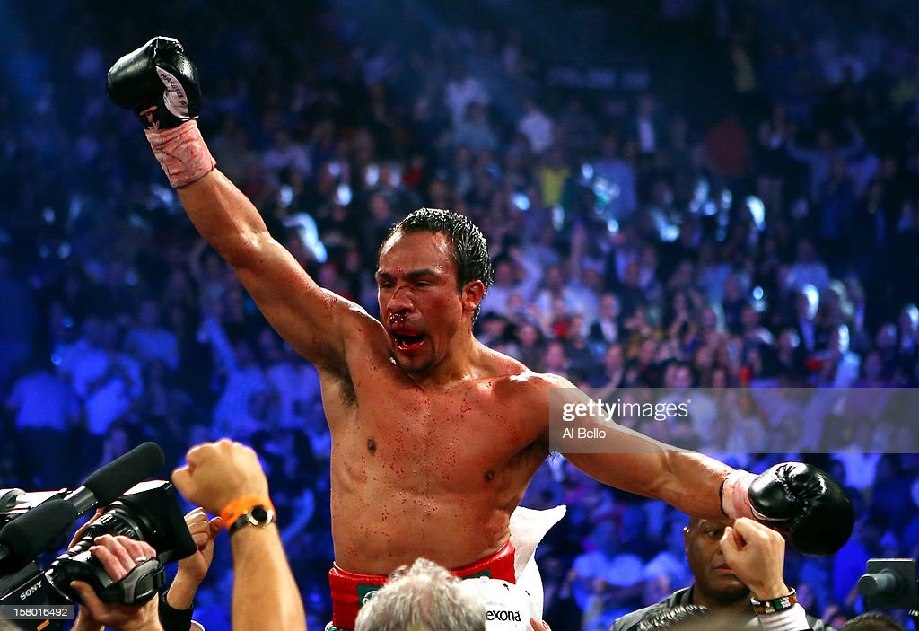 Juan Manuel Marquez celebrates after defeating Manny Pacquiao by a sixth round knockout in their welterweight bout at the MGM Grand Garden Arena on December 8, 2012 in Las Vegas, Nevada.