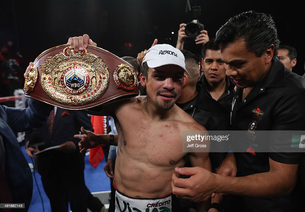 <a gi-track='captionPersonalityLinkClicked' href=/galleries/search?phrase=Juan+Manuel+Marquez&family=editorial&specificpeople=4202669 ng-click='$event.stopPropagation()'>Juan Manuel Marquez</a> celebrates his victory over Mike Alvarado at The Forum on May 17, 2014 in Inglewood, California.