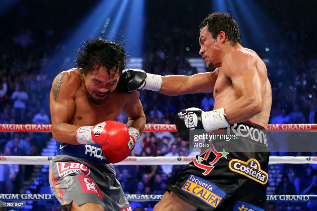 Juan Manuel Marquez lands a right to the face of Manny Pacquiao during their welterweight bout at the MGM Grand Garden Arena on December 8, 2012 in Las Vegas, Nevada.